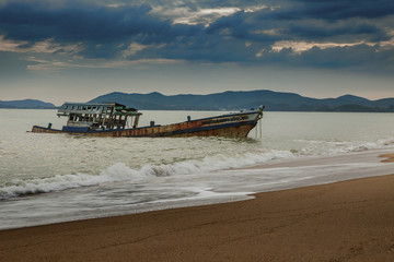 sea scape of wreck boat on beach
