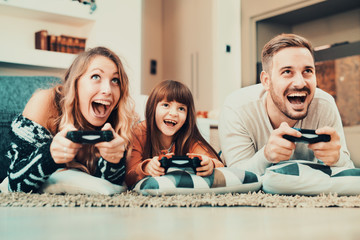 Competitive family playing video games at home