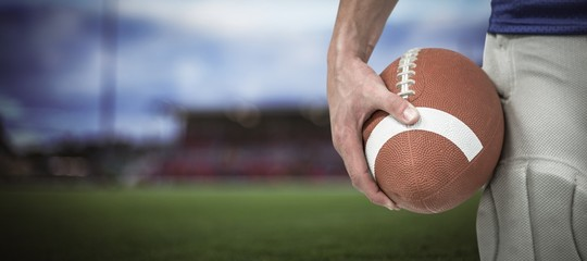 Composite image of close-up of sports player holding ball