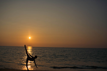 silhouette of a young and graceful woman on a background of the