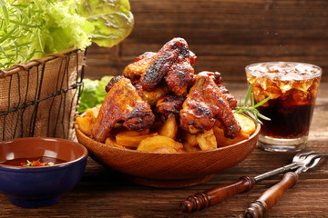 Chicken wings with baked potatoes and barbecue sauce