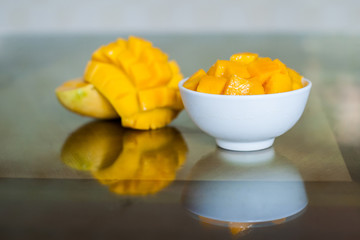 Mango sliced in a bowl on the table