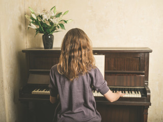 Young woman playing piano at home