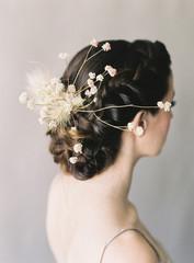 Portrait of bride in bridal wear, focus con hair