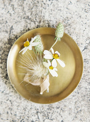 Boutonniere on gold dish