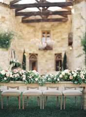 Floral arrangements for wedding reception, laid out on table
