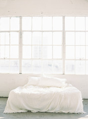 Bed in front of window