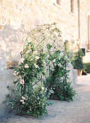 Floral arch against wall