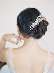 Portrait of bride in bridal wear, focus con hair
