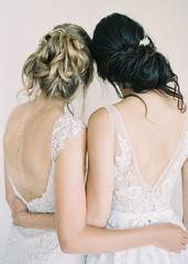 Two women wearing bridal wear, rear view