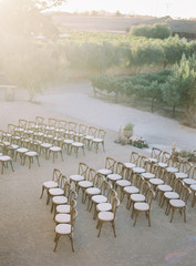 Chairs arranged in rows for wedding ceremony, elevated view