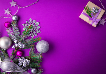 purple christmas background with a present buy this stock photo