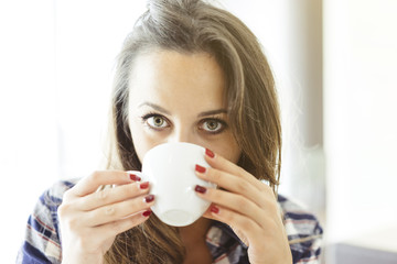 young woman drinking a coffee