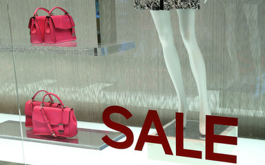 sale sign on clothing shop