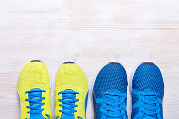 Two Pair of blue and yellow sport shoes on white background