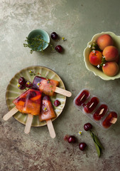 Ice pops made from apricot and cherry, overhead view