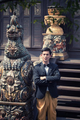 Asian man wearing traditional suit culture thai, a man was stand