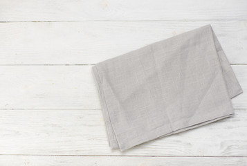 Gray napkin isolated on white wooden table.. Copy space. Top view.