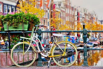 Obraz Bycicle parked at the bridge - fototapety do salonu