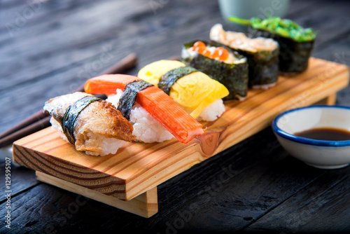 sushi set served on dark wooden table stockfotos und lizenzfreie bilder auf bild. Black Bedroom Furniture Sets. Home Design Ideas