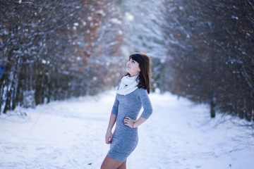 Pretty girl standing in a winter park