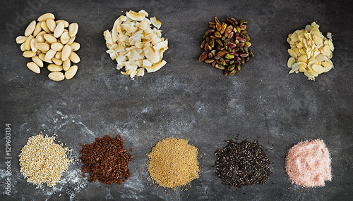 various superfoods and nuts on a dark grey background quinoa flex