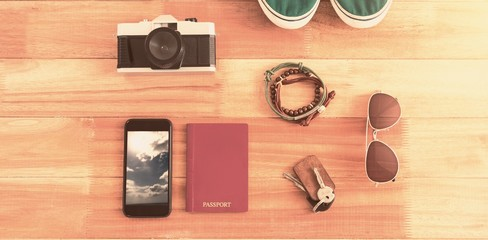 Composite image of travelling accessories and various items