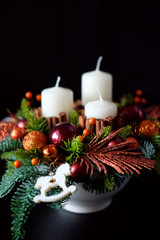 Winter table centerpiece wreath with candles, new year toys