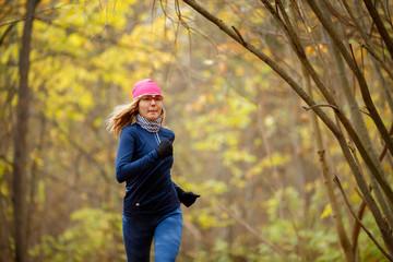 Beautiful woman running in morning
