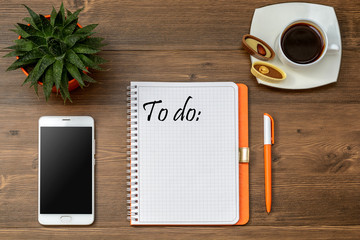 Business accessories on desktop: notebook, diary, fountain pen,