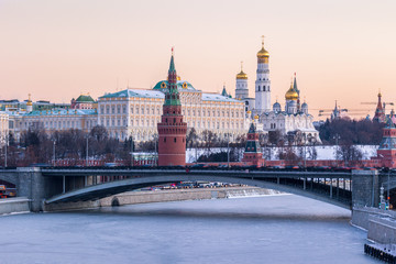 Moscow Kremlin and frozen Moscow River at frosty winter day. View from Patriarshy bridge.