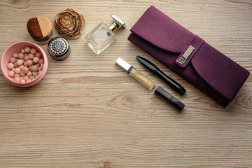 The composition of women's accessories, cosmetics on wooden table