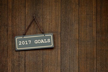 2017 goals - the message on the signage hanging at the vintage wood door