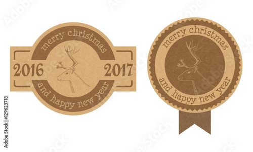 vintage textured cardboard christmas and new year labels or badges with hand drawn reindeer
