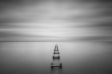 Long Exposure Seascape of some old pilings  Wall mural