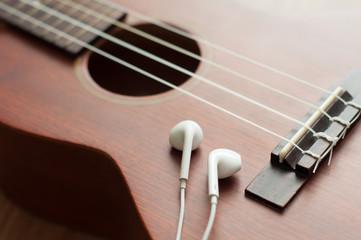 earphones on the ukulele