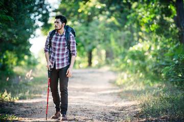 Young hipster man walking on the rural road during hikes on vaca