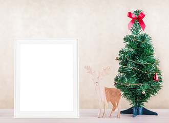 white frame photo Decorated and Decorated christmas Tree on Wood
