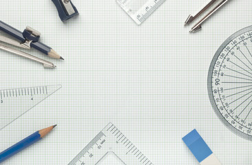 Mathematical instruments on graph paper