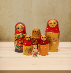 Matryoshka, national russian dolls on wooden table