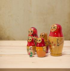 Matryoshka, national russian dolls on grunge background
