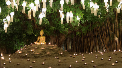 buddha image statue and candle light