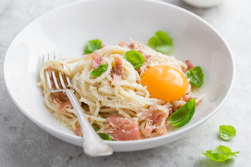 pasta carbonara with prosciutto,  parmesan cheese and eggs yolk