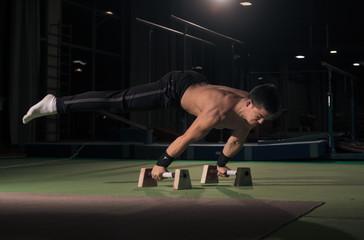 man gymanst in air, two hands cartwheel