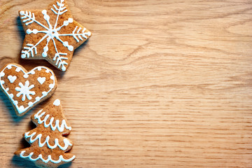 Merry Christmas and Happy new year! Christmas cookies on wooden background. Top view. Copy space for your text