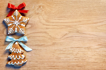 Two Gingerbread cookies on wooden table. Close up, top view. Merry Christmas and Happy New Year!