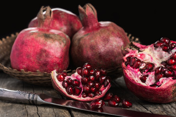 Pomegranates on wooden background