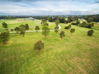 Aerial view of Trees and sports grounds at Bcentennial Park in Chelsea, Melbourne, Australia