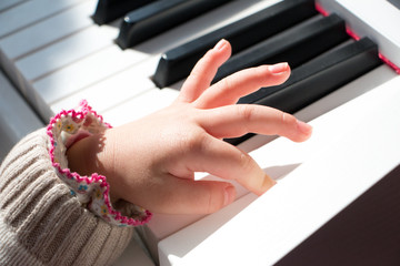 hand touch piano keys