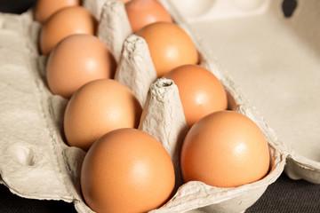 Chicken eggs in a cardboard box. Bio food.